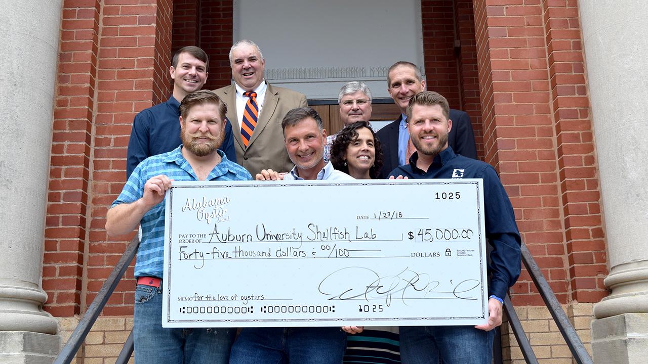 Oyster Social check donation to the Auburn University Shellfish Lab, Dauphin Island, Alabama