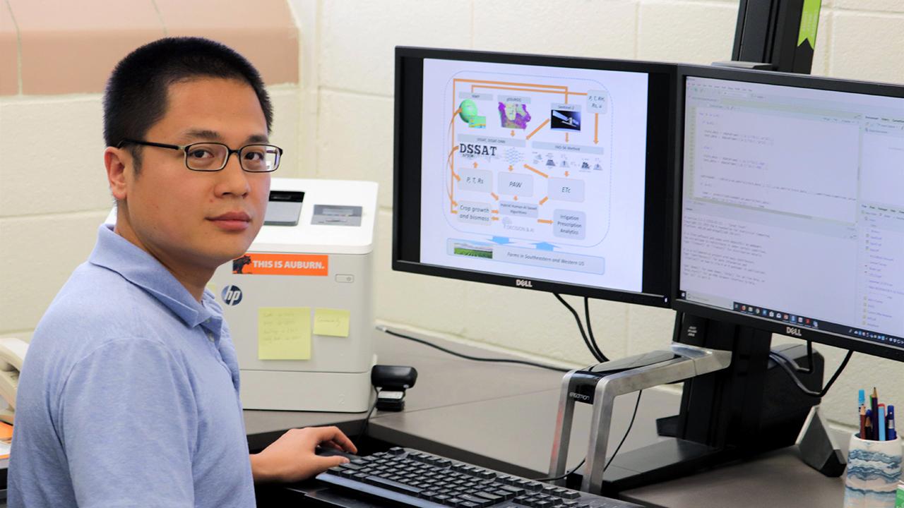 Di Tian in research lab with computer models, Auburn, Alabama, USA