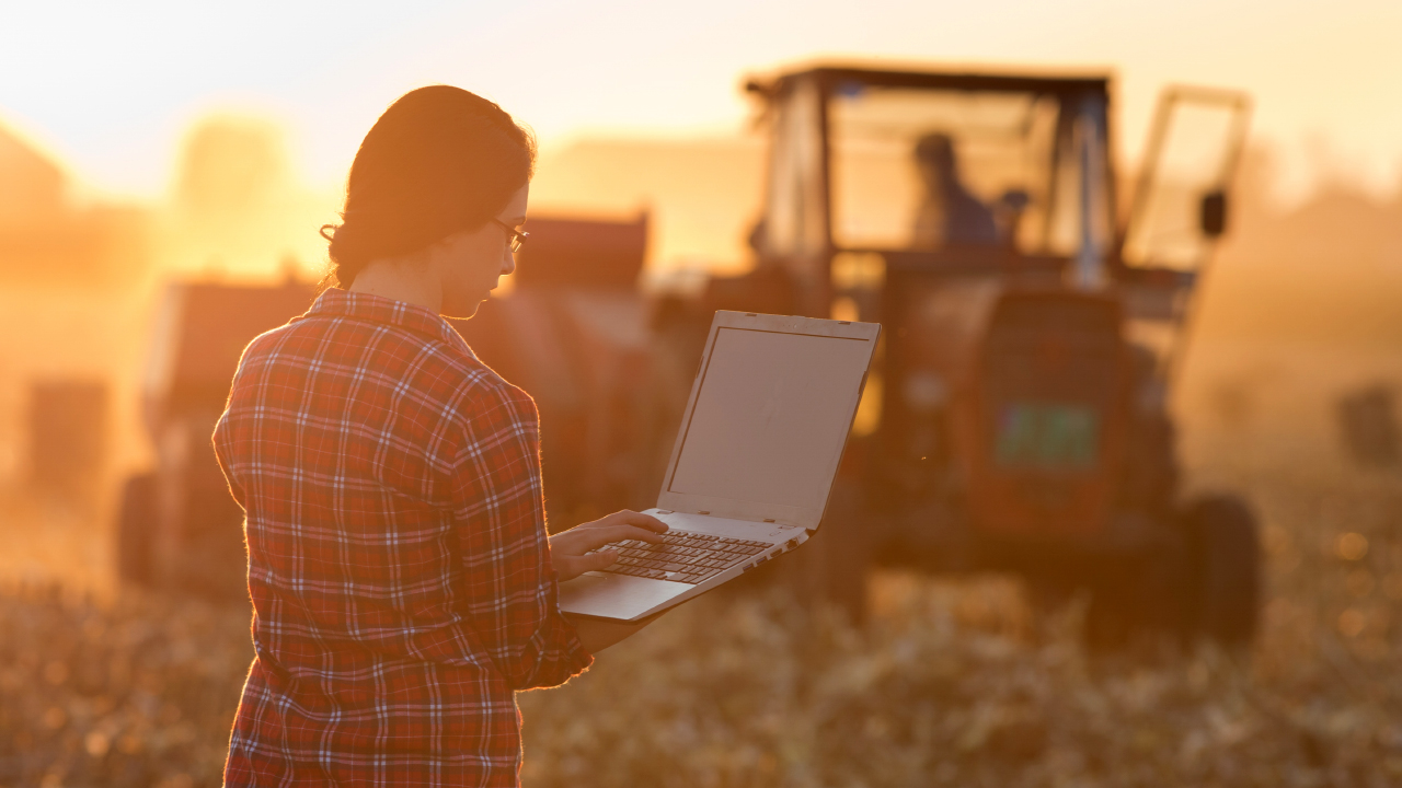 girl-in-plaid-with-laptop-farm-tractor-header
