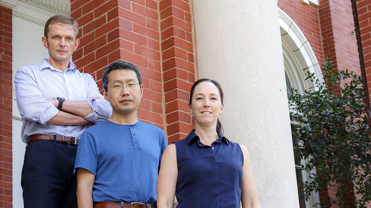 Auburn Agriculture Economics & Rural Sociology NSF Research Grant team, Left to right, Denis Nadolnyak, Ruiqing Miao and Michele Worosz