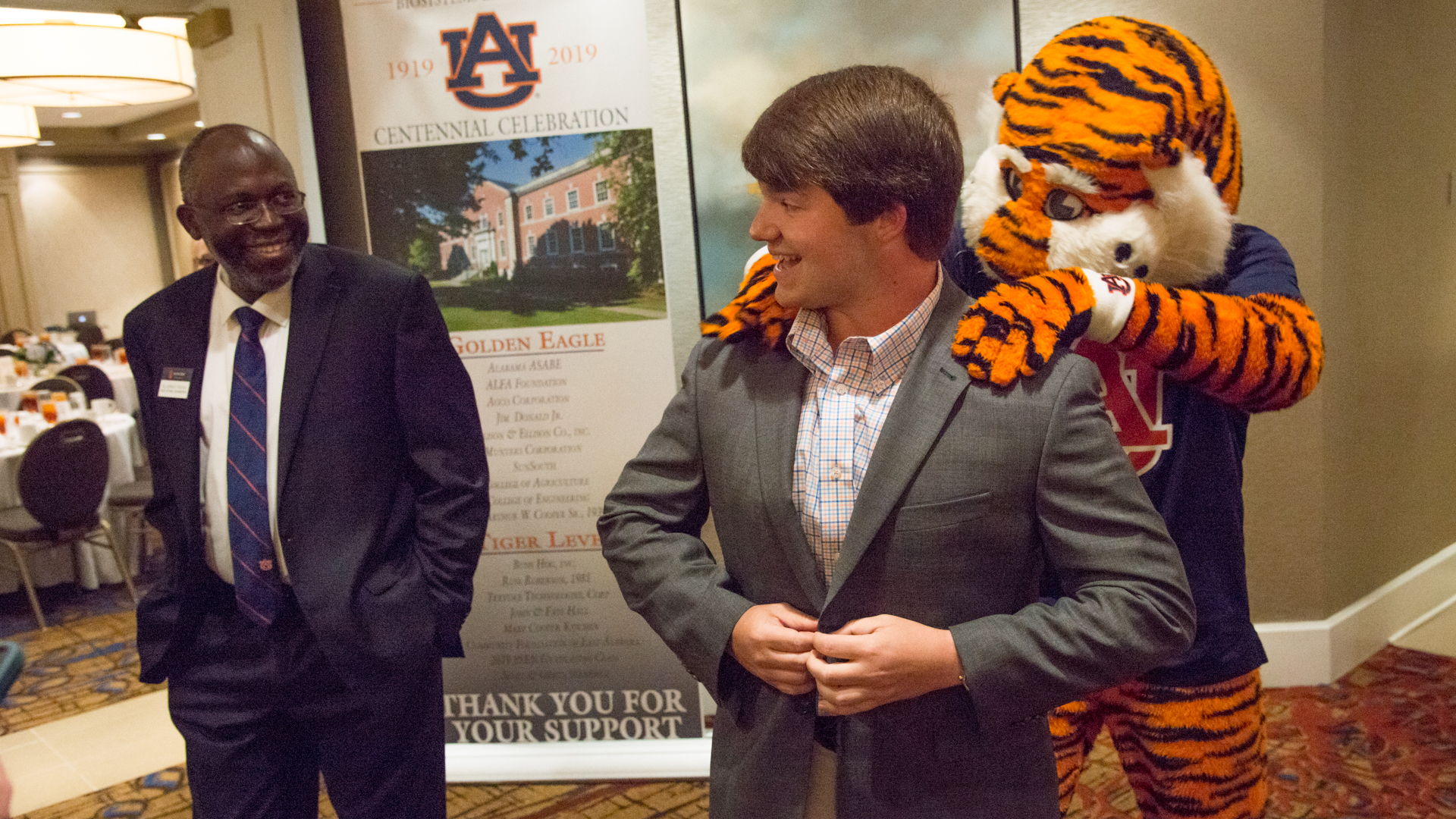 Aubie massaging a Biosystems Engineering college student's shoulders at Centennial Celebration, The Hotel at Auburn, Alabama, USA