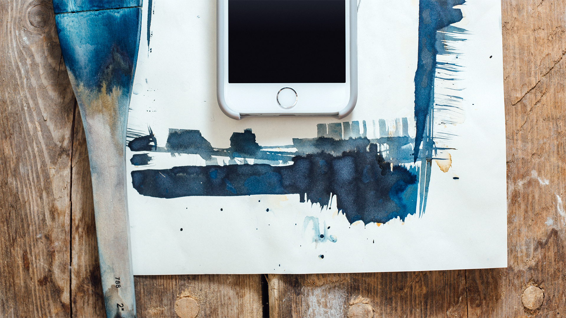 mobile-phone-social-blue-paint-brush-on-wood-sm