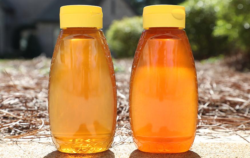 Two bottles of granulated honey