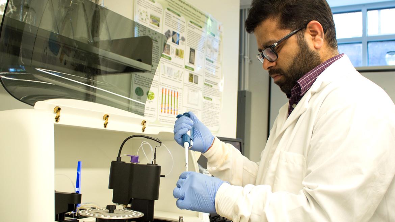 Photo of Jasmeet Lamba, Auburn Biosystems researcher in lab