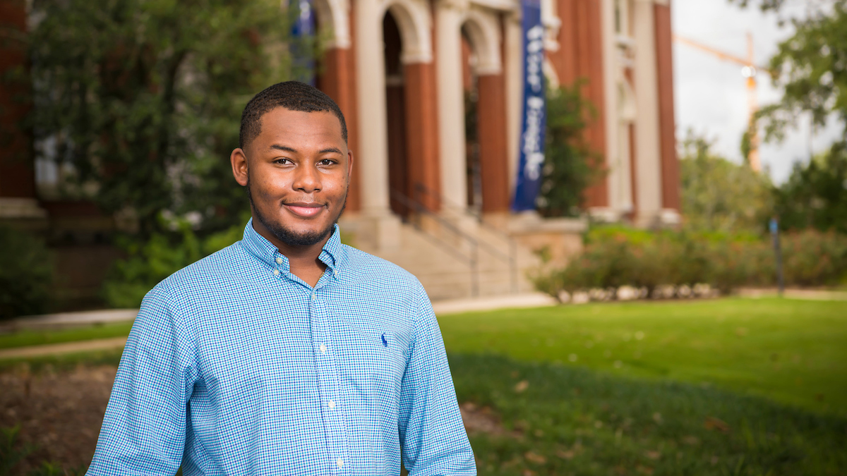 Kenneth Reese poses for a picture outside Comer Hall on Auburn's campus, Alabama, USA