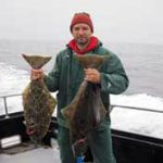 Matt-Catalano-Auburn-FAAS-photo-holding-fish-square