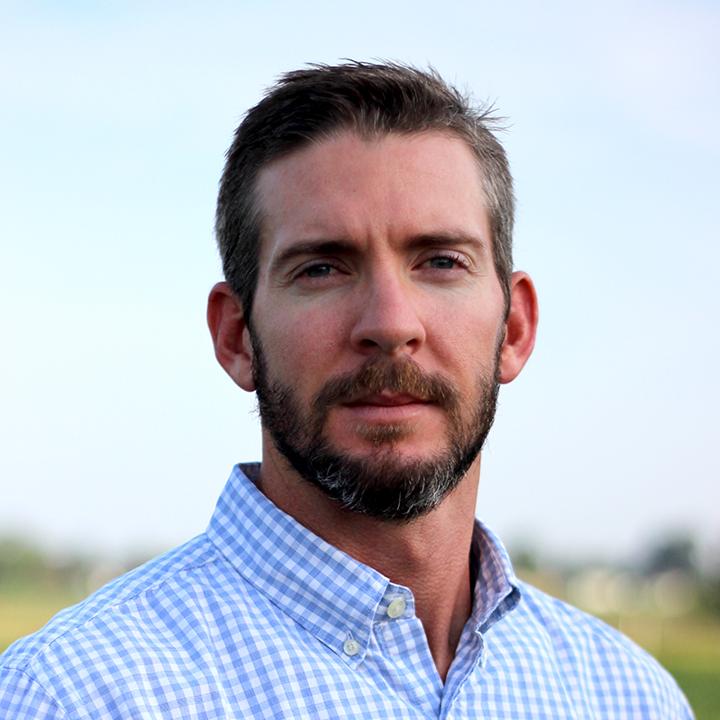 Tyler-Sandlin-Auburn-CSES-photo-headshot-in-farm-field-square-5775