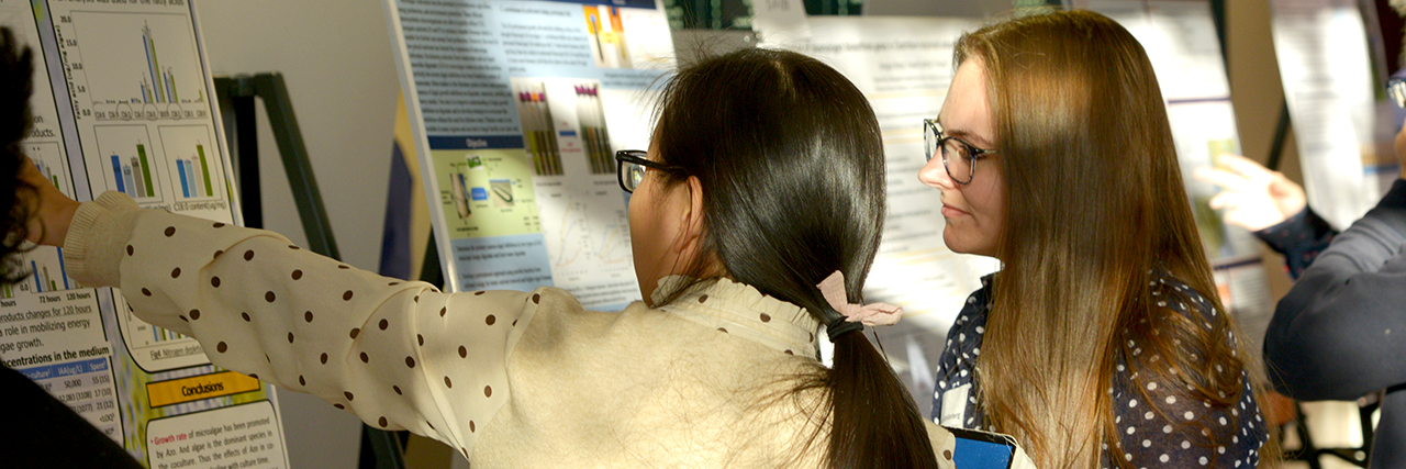 2 Southern college girls, research grad students, graduate poster showcase event.