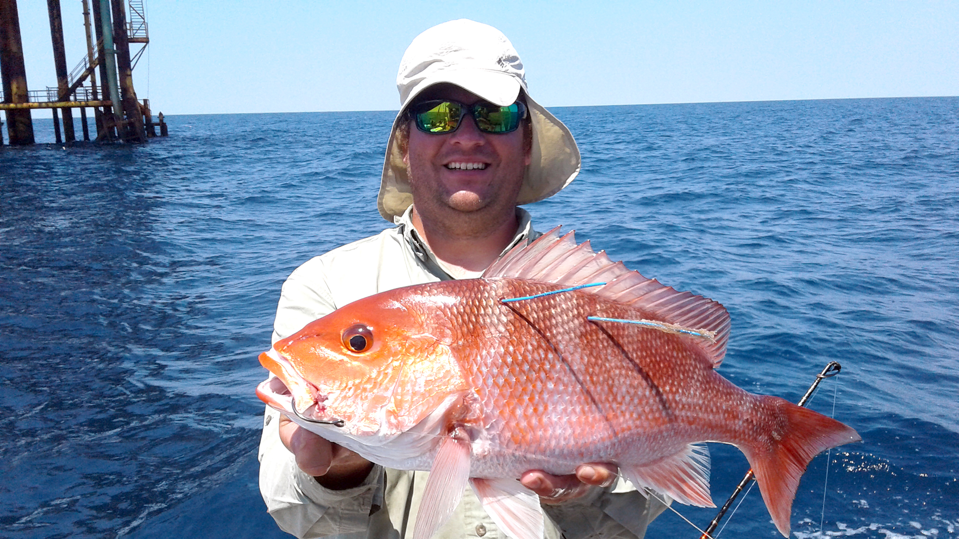 Peter-Mudrak-red-snapper-fish-recapture-in-Gulf-of-Mexico-Ocean-Sunny-Day-near-water-dock-tagged-2020