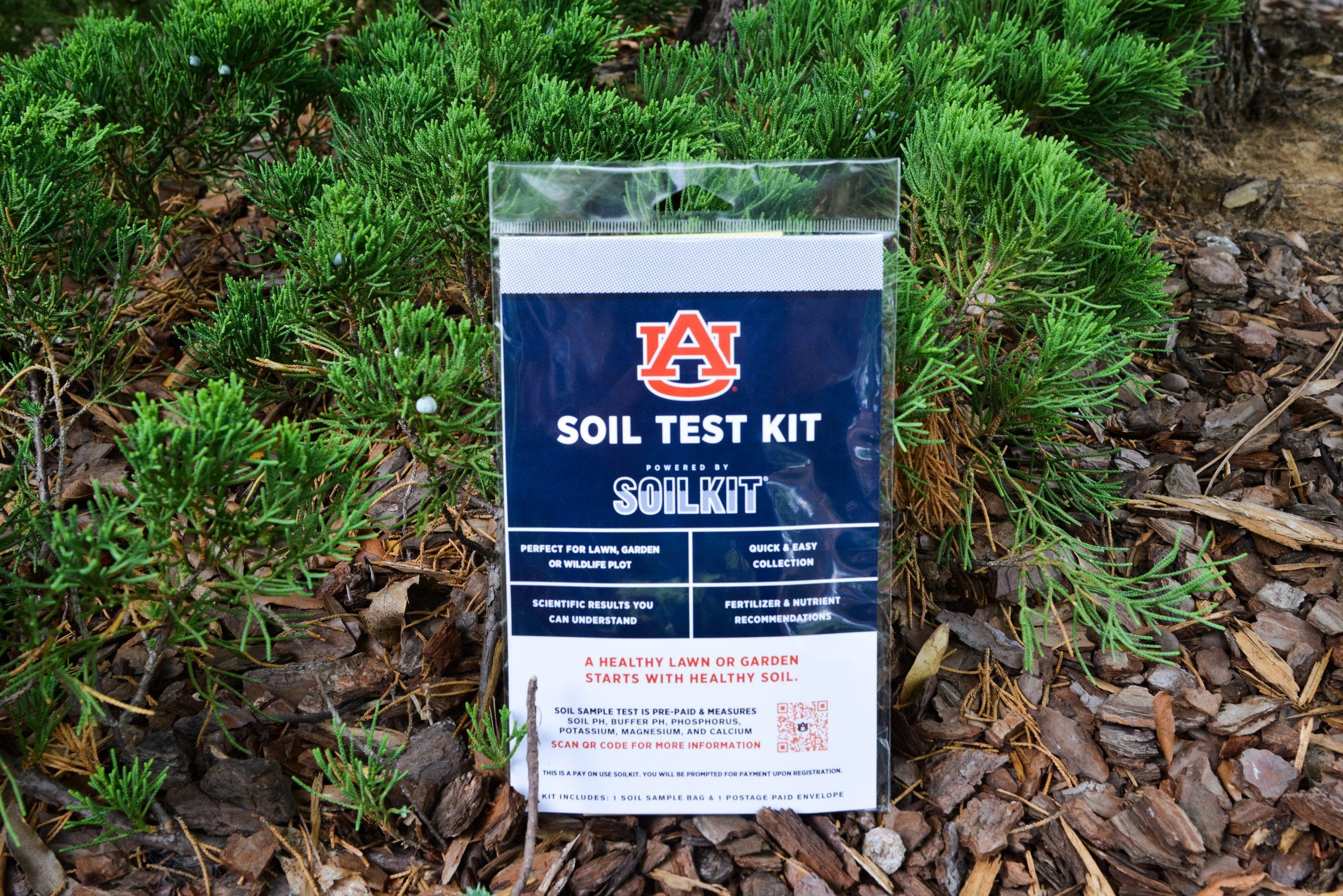 The Auburn branded soilkit sits in a garden bed