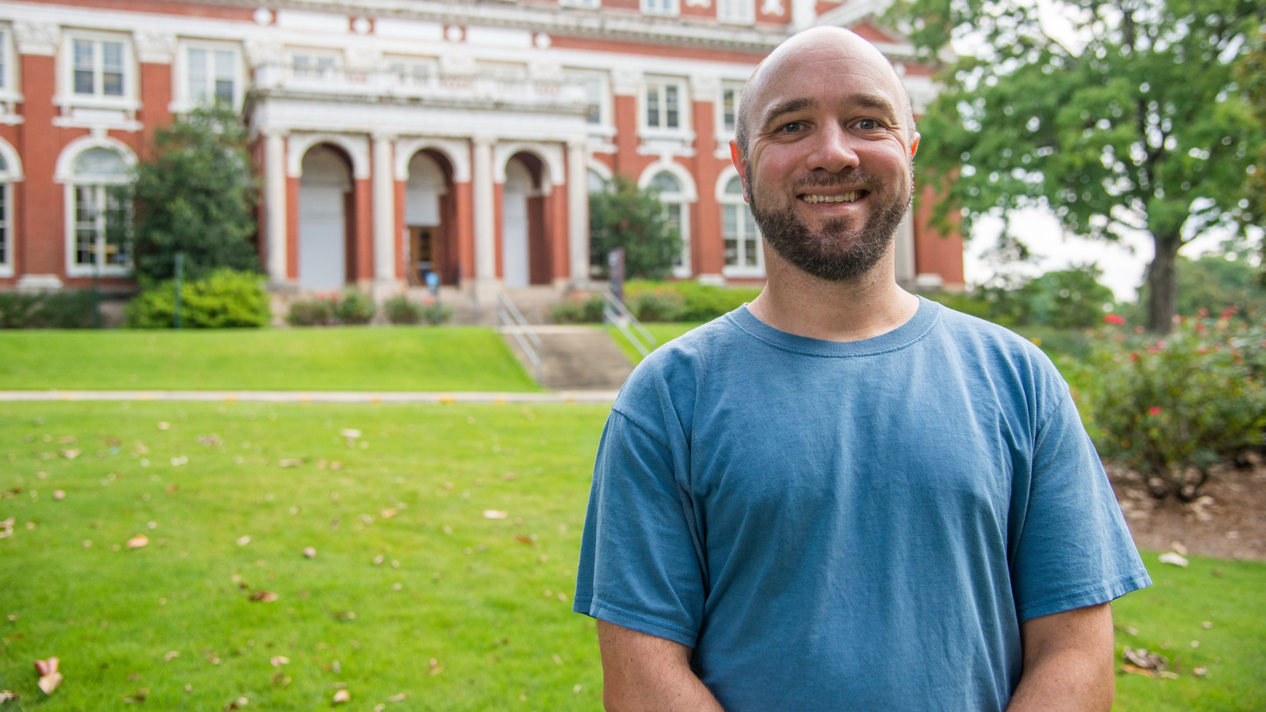 Joel Cuffey smiles in front of Comer Hall