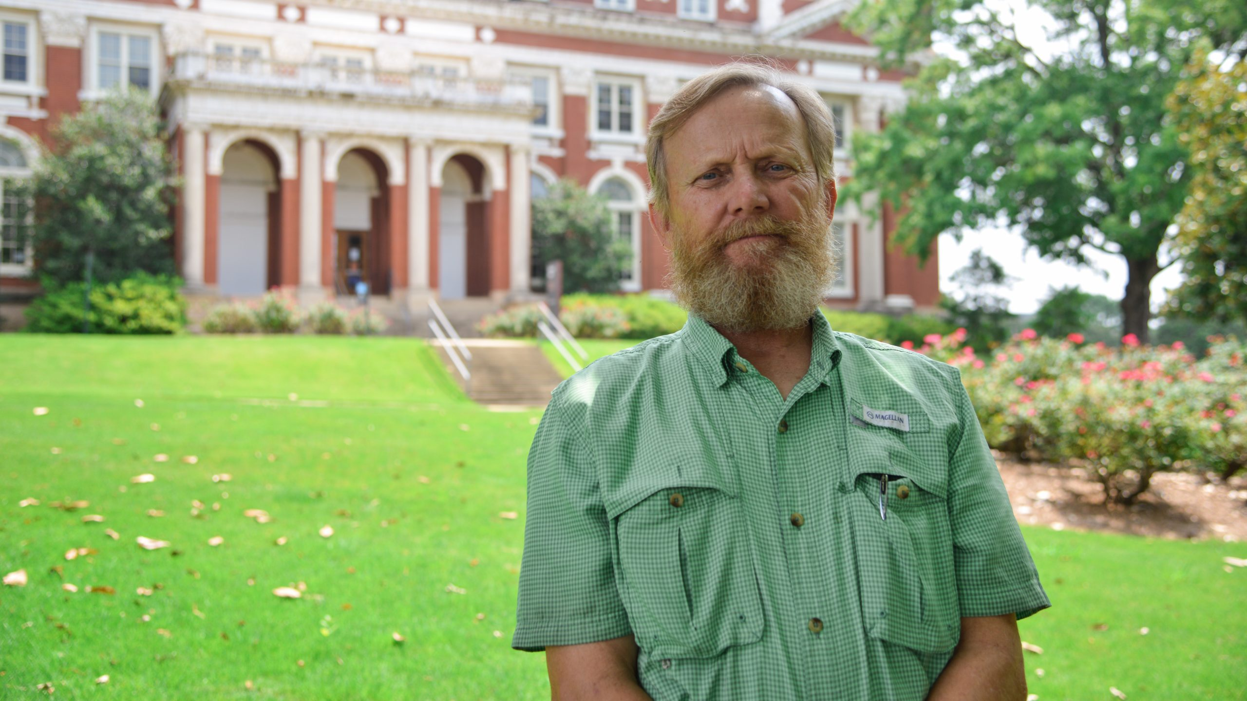 Wheeler Foshee smiles for the camera in front of Comer Hall