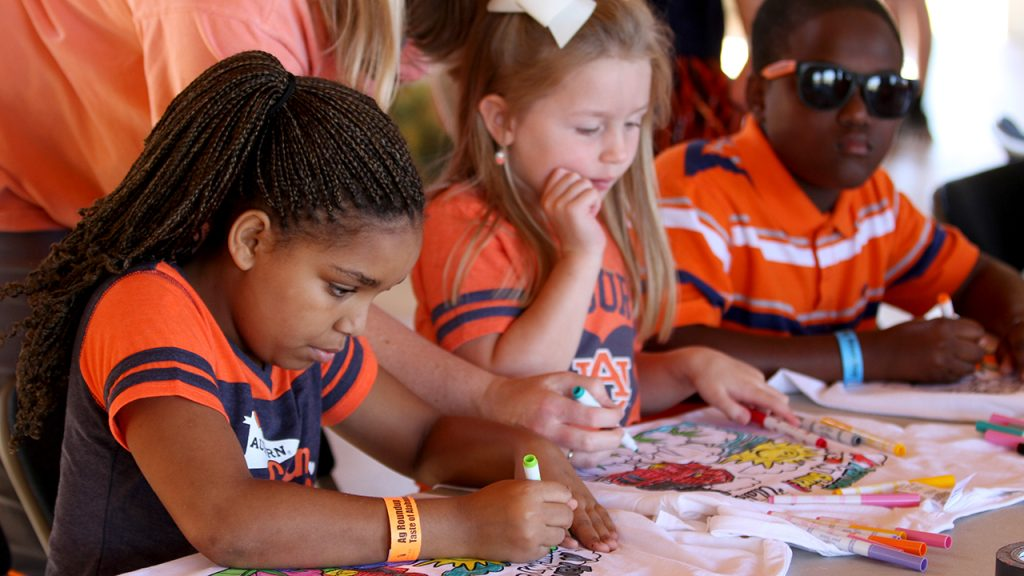 Ag Roundup, Auburn, AL Event, kids coloring T-shirts with markers at Ag Heritage Park